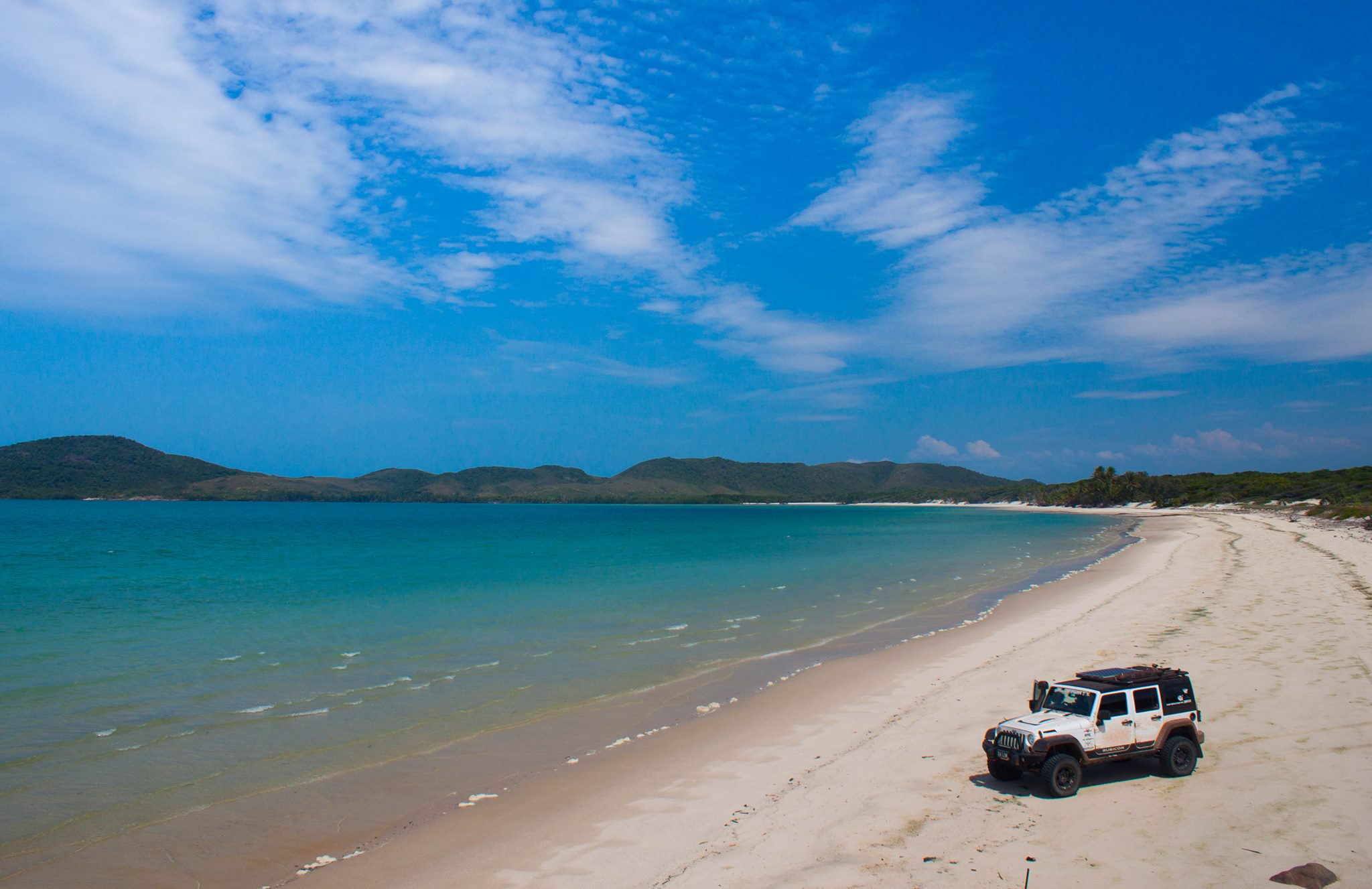 Clear skys and clear water and beach driving