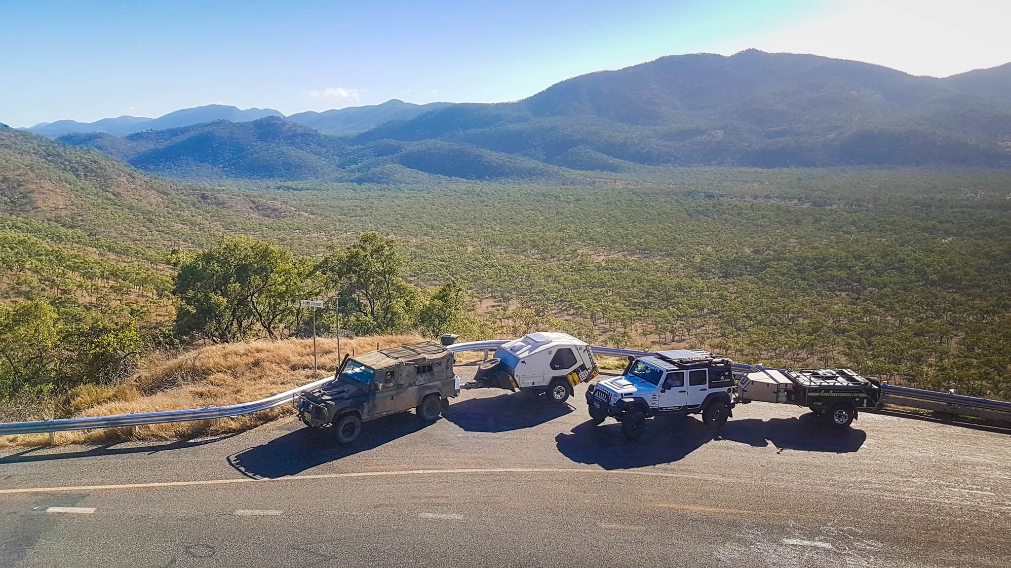 Jeeps parked at a roadside lookout
