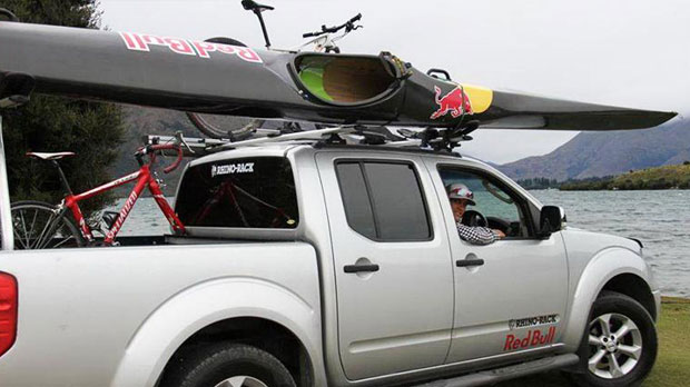 Triathlete Braden Currie driving to train with Rhino-Rack Kayak and bike carriers