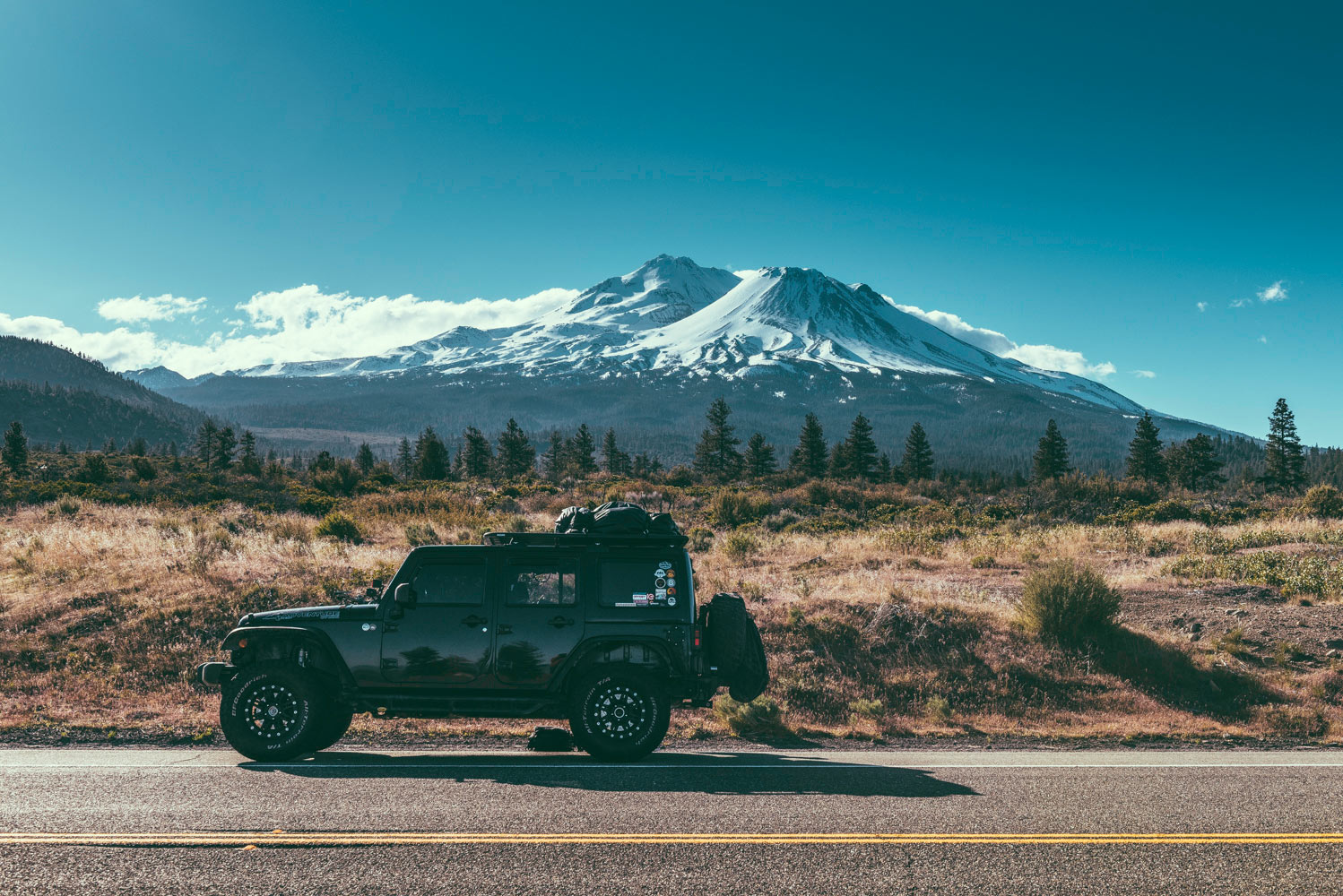 Jeep with snowy mountain backdrop