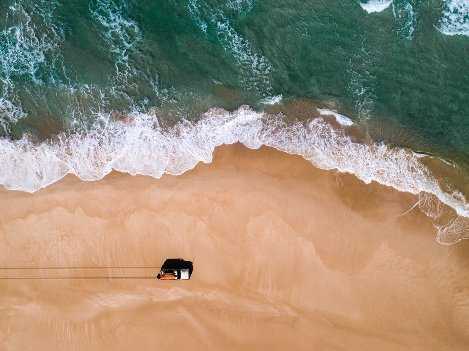 Blacksmiths Beach drone photography: Driving by the water